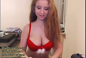 Busty redhead gets naked - live at link