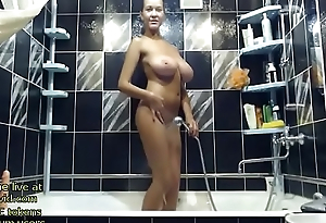 Blonde Milf shows her huge boobs in the shower - live to hand link