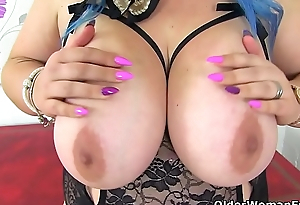 English milf Kiki Rainbow spoils us with her huge tits