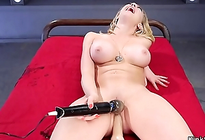 Busty gets machine in pierced pussy