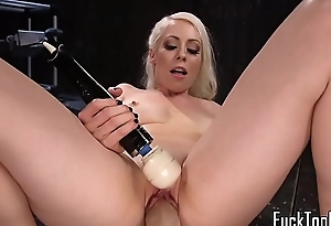 MILF babe orgasms while stuffed with dildo