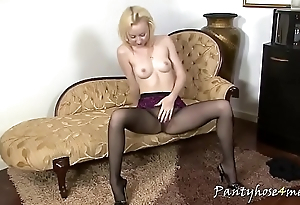 Slim blonde with firm pair poses in pantyhose